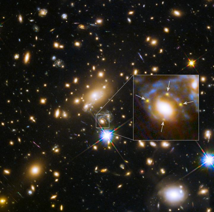 Four images of supernova Refsdal, split by a cosmic lens
